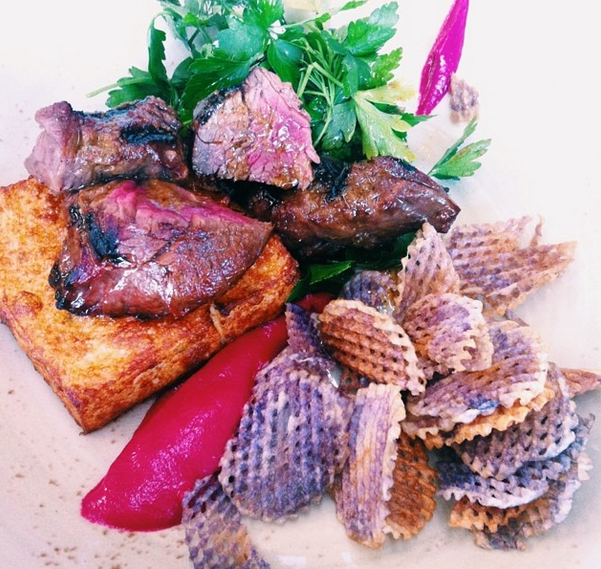 Nobody does brunch quite like Melbourne. Presenting: Steak and polenta, with purple potato chips from Auction Rooms.